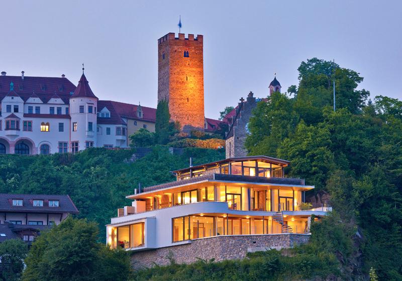 Domizil Weitblick in den Tiroler Bergen Panoramafenster wohngesund von Baufritz